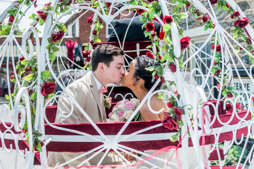 bride and groom carriage kiss