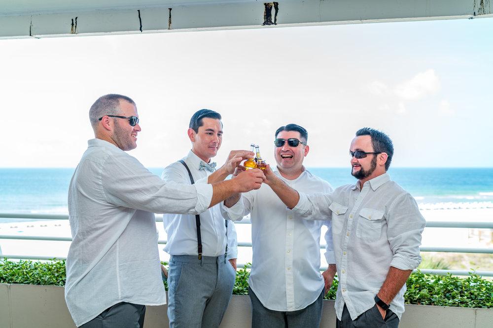groomsmen-cheers-groom-suspenders.jpg