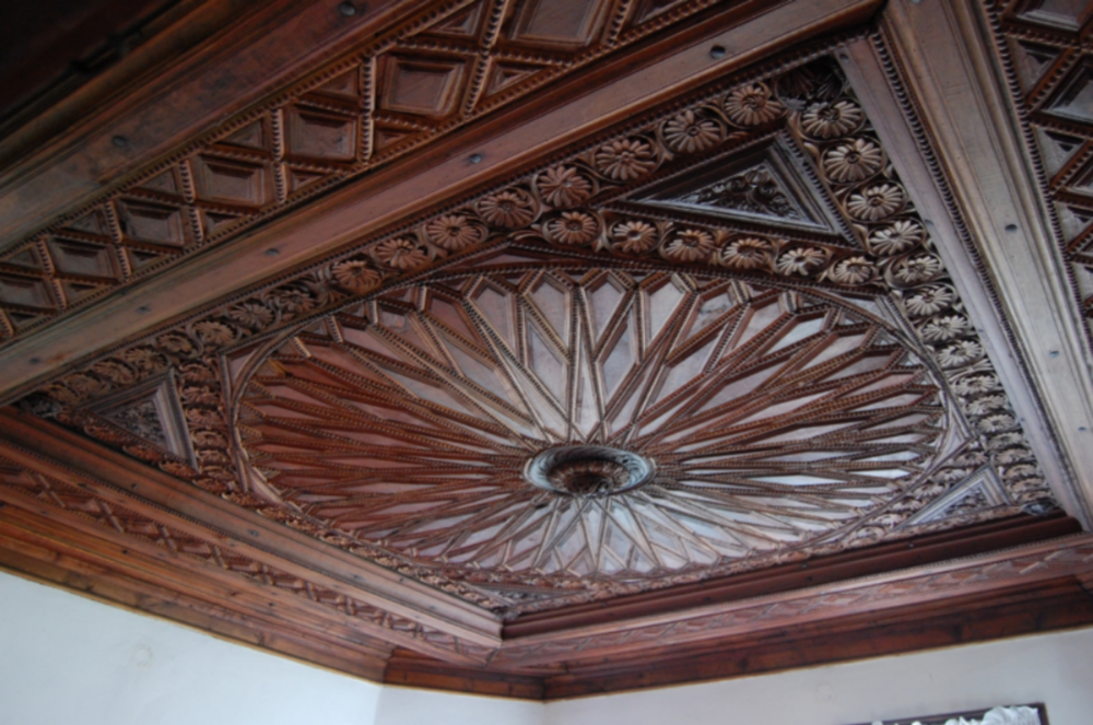 Beautiful carved wooden ceilings were in the rich National Revival homes. See wood-carving museum link at end.   Photo © Del Weliver