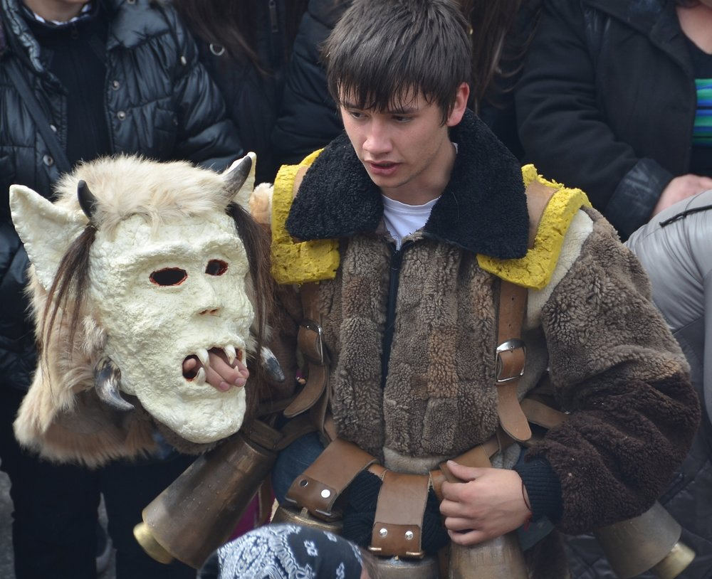 The costumes are hot and heavy.  Shiroka Laka, Bulgaria, Mummers' Festival.  ©   Del Weliver