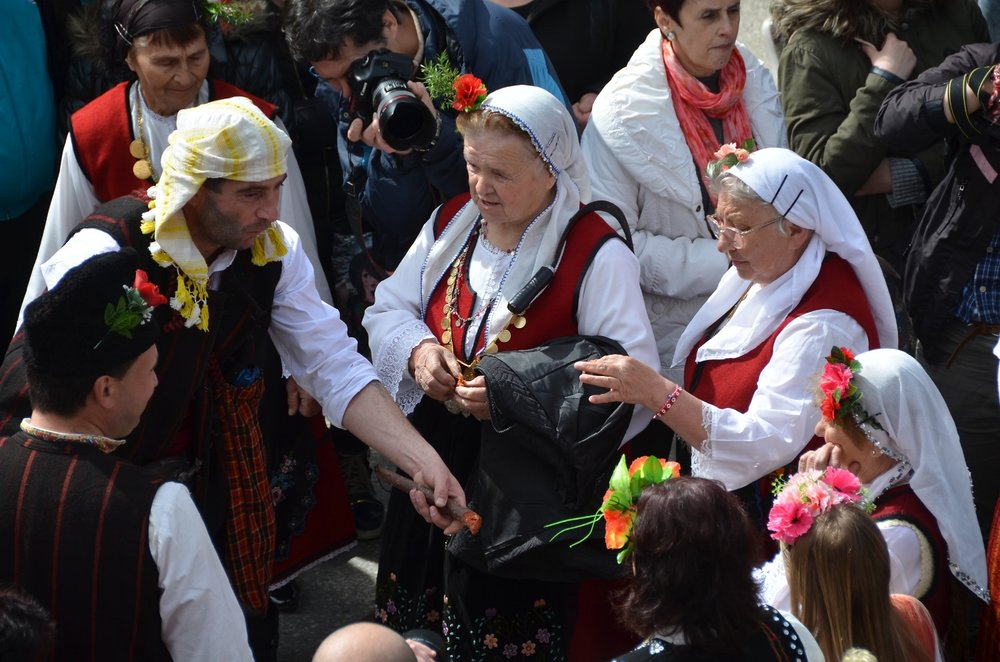 Folk costumes are worn by these older women.  Shiroka Laka, Bulgaria, Mummers' Festival.  ©   Del Weliver