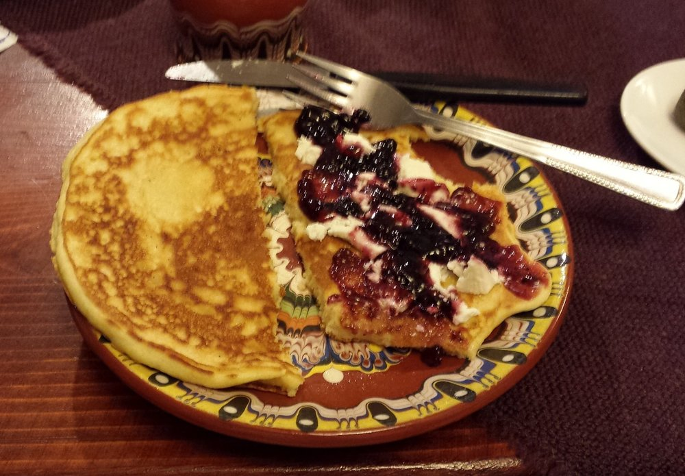 _084414  Breakfast featured homemade wild blueberry jam over white Bulgarian cheese on an 8 inch pancake.  Delicious.  4 of us ate the whole bowl of jam!