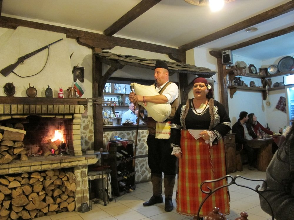 IMG_2859  A folk  singer joined the kaba gaida.  The wood fire made the restaurant cozy on this March evening.  © Evelyn Weliver