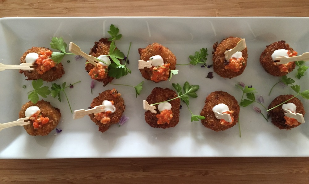 Roasted onion and potato croquetta, creme fraiche, romesco sauce