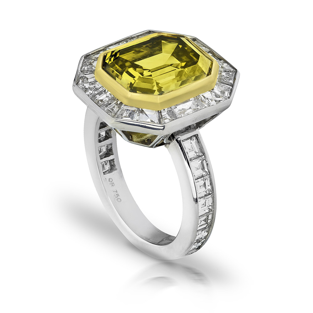 FANCY DEEP GREEN YELLOW EMERALD CUT DIAMOND WITH COLORLESS BAGUETTE CUT DIAMONDS CRAFTED IN 18K GOLD AND PLATINUM, 7.91 CTW
