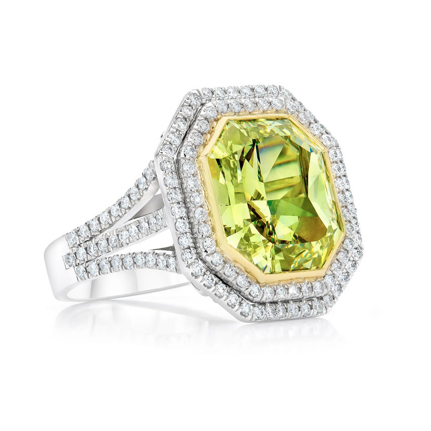 FANCY DEEP GREEN YELLOW RADIANT CUT DIAMOND WITH DOUBLE HALO OF COLORLESS DIAMONDS CRAFTED IN 18K GOLD AND PLATINUM, 12.62 CTW, SIDE VIEW
