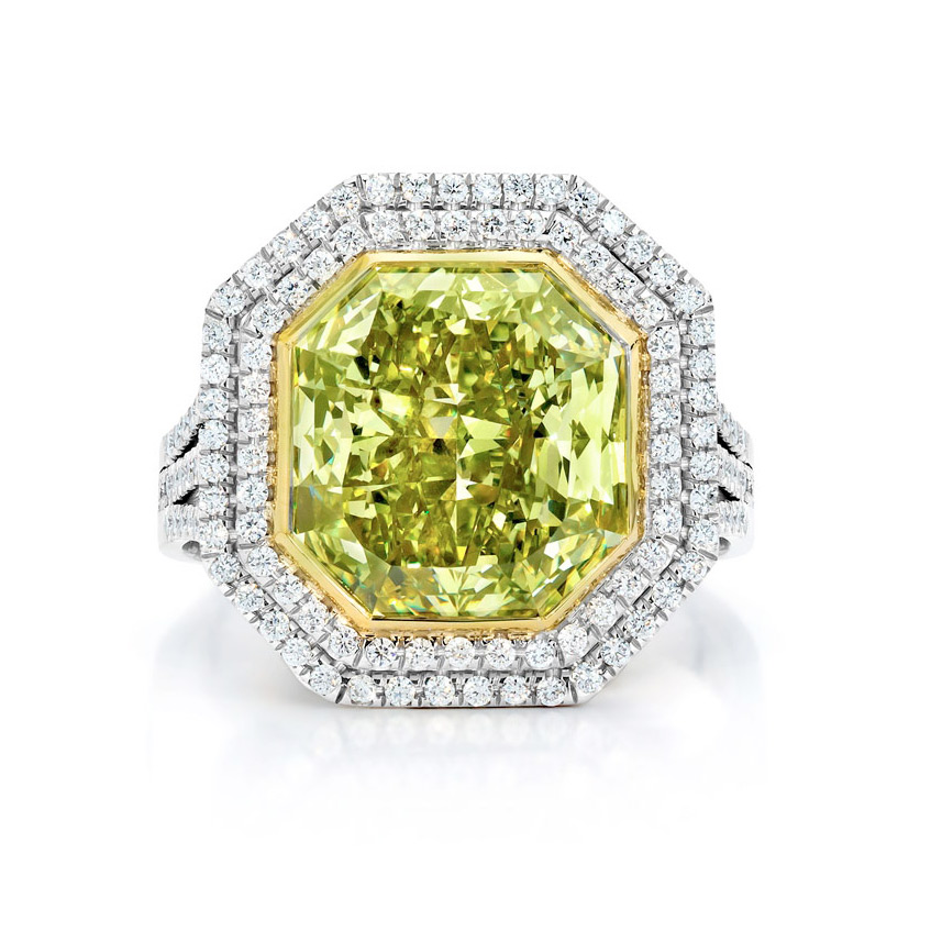 FANCY DEEP GREEN YELLOW RADIANT CUT DIAMOND WITH DOUBLE HALO OF COLORLESS DIAMONDS CRAFTED IN 18K GOLD AND PLATINUM, 12.62 CTW