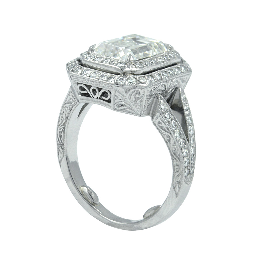 EMERALD CUT CENTER DIAMOND WITH TWO ROWS OF DIAMOND PAVE, MILGRAIN AND HAND ENGRAVED DESIGN, CRAFTED IN PLATINUM, 7.89 CTW,  SIDE VIEW