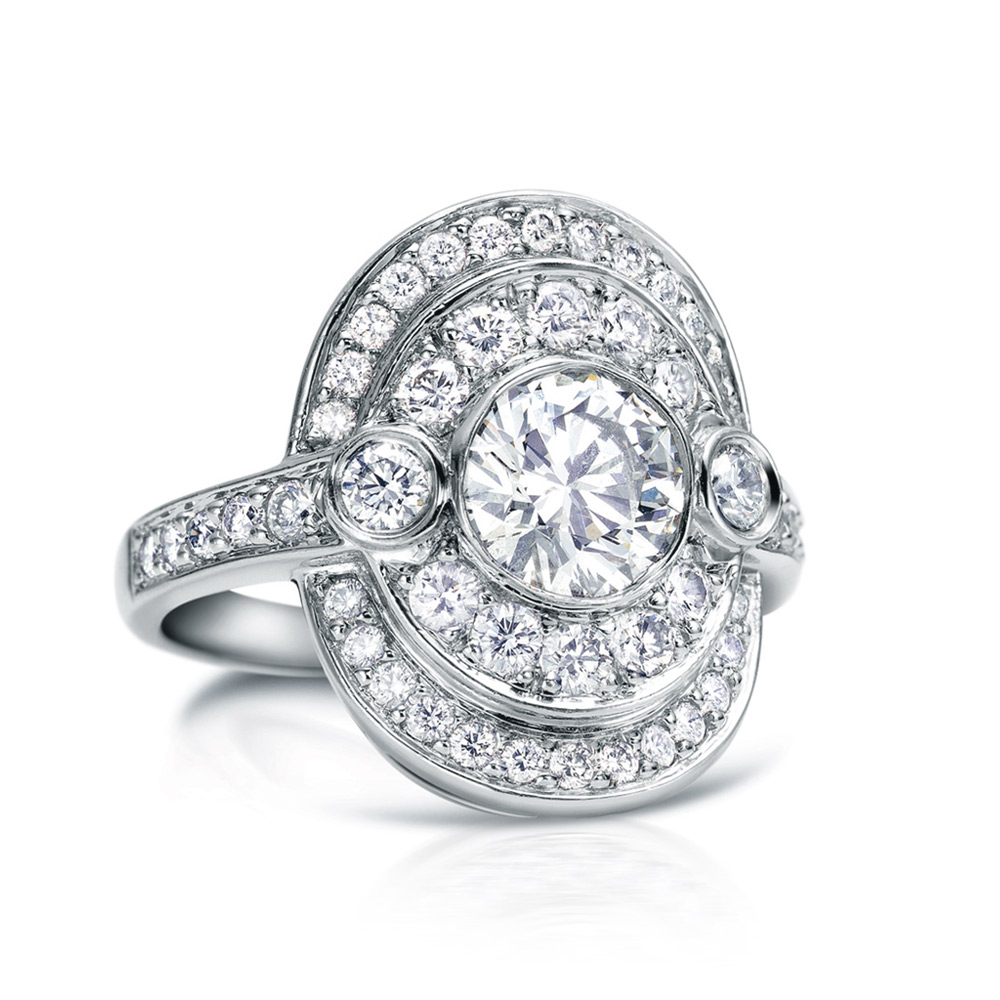 ROUSSEAU RING WITH ROUND BEZEL SET CENTER DIAMOND, WITH BEZEL AND PAVE SET DIAMONDS, CRAFTED IN PLATINUM, 2.15 CTW