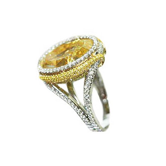 FANCY LIGHT YELLOW OVAL WITH FANCY YELLOW AND COLORLESS DIAMOND PAVE, CRAFTED IN 18K YELLOW GOLD AND PLATINUM, 18.13 CTW, SIDE VIEW