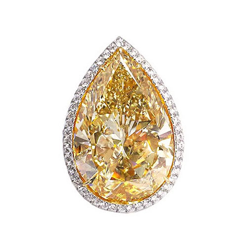 FANCY BROWNISH YELLOW PEAR SHAPE DIAMOND WITH COLORLESS DIAMOND PAVE, CRAFTED IN 18K YELLOW GOLD AND PLATINUM, 18.67 CTW, TOP VIEW