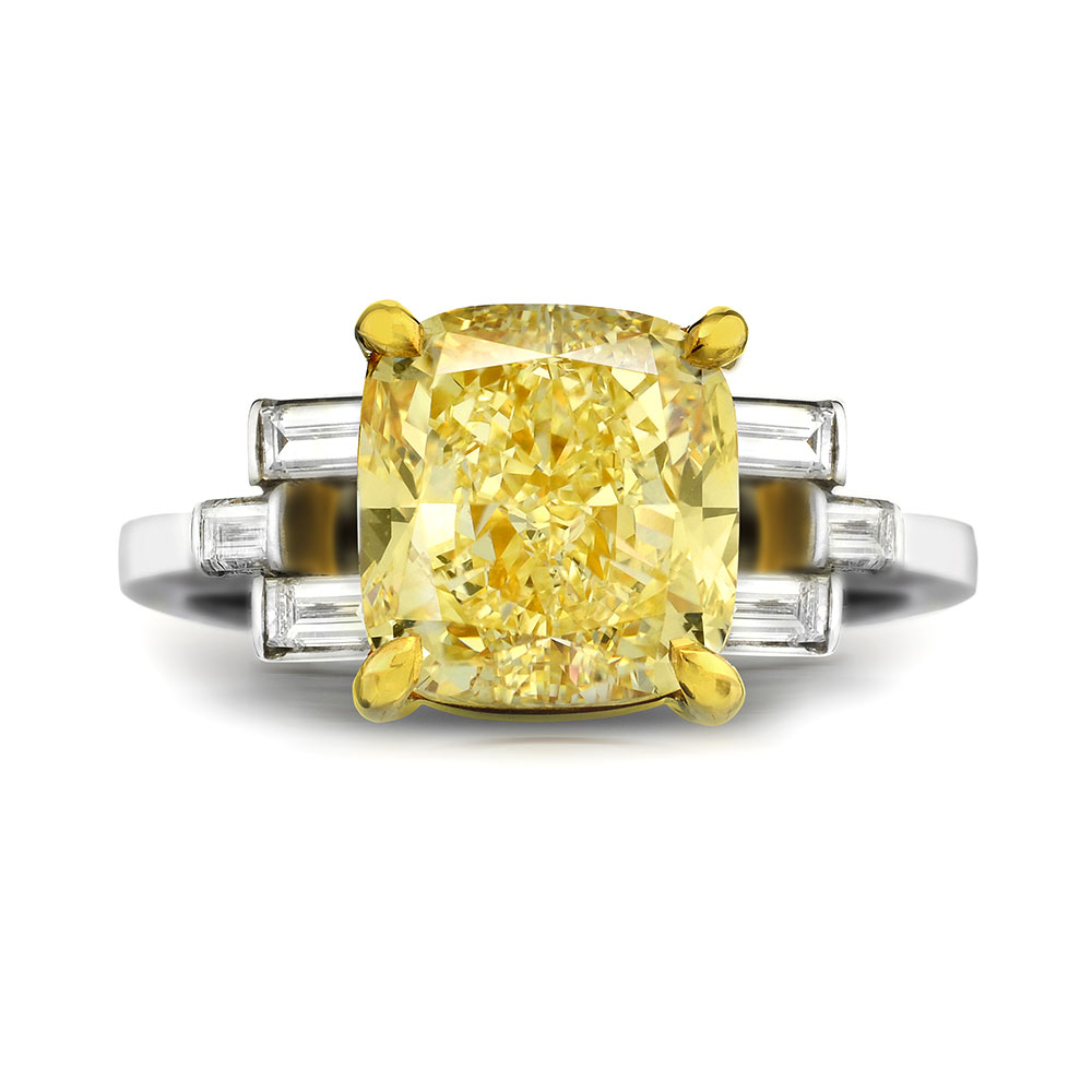 FANCY YELLOW CUSHION CUT DIAMOND WITH STRAIGHT BAGUETTE CUT DIAMONDS CRAFTED IN 18K AND PLATINUM, 3.57 CTW