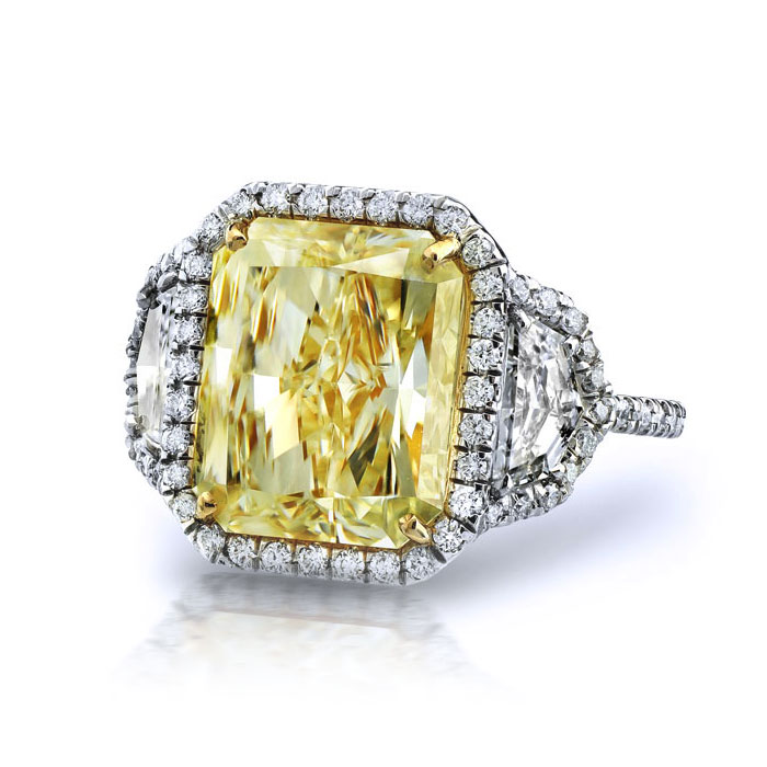FANCY LIGHT YELLOW RADIANT CUT DIAMONDS WITH COLORLESS CADILLAC CUT AND ROUND DIAMONDS CRAFTED IN 18K AND PLATINUM, 8.16 CTW