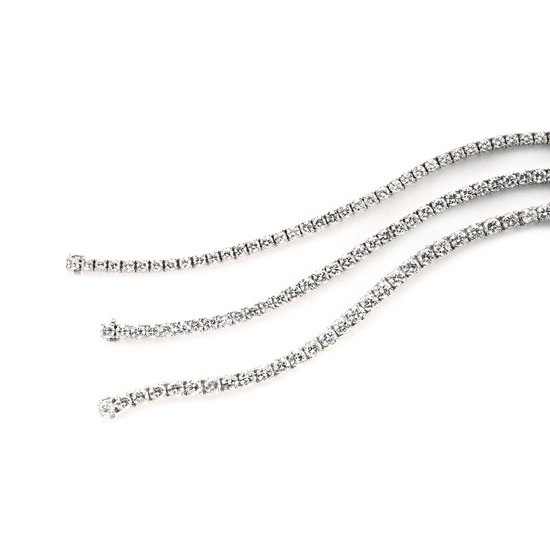 COLLECTION OF STRAIGHT-LINE BRACELETS CONTAINING COLORLESS AND NEAR-COLORLESS DIAMONDS, CRAFTED IN PLATINUM, RANGING 10 TO 18 CTW