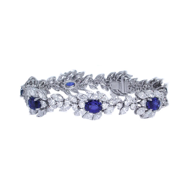 SAPPHIRE AND COLORLESS DIAMOND CLUSTER BRACELET CRAFTED IN PLATINUM