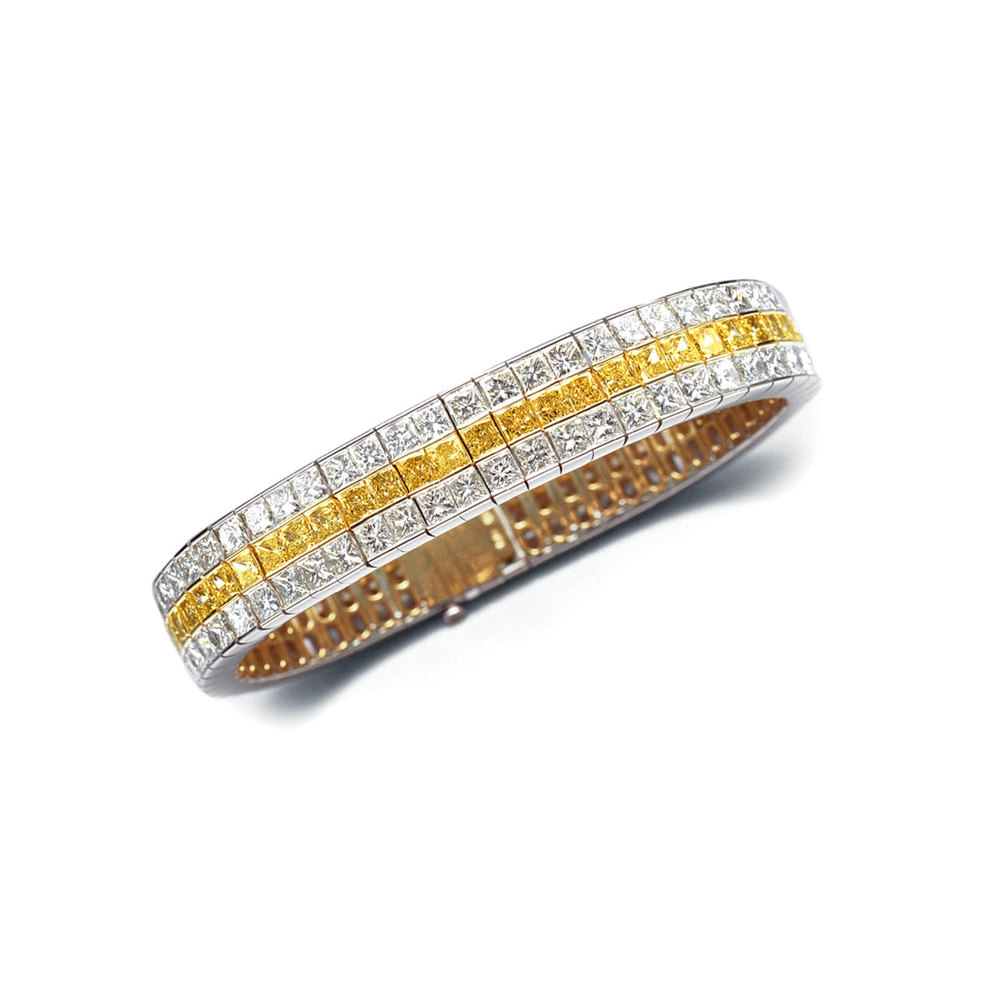 TRIPLE ROW BRACELET FEATURING FANCY INTENSE YELLOW AND COLORLESS PRINCESS CUT DIAMONDS, CRAFTED IN 18K AND PLATINUM, 34 CTW