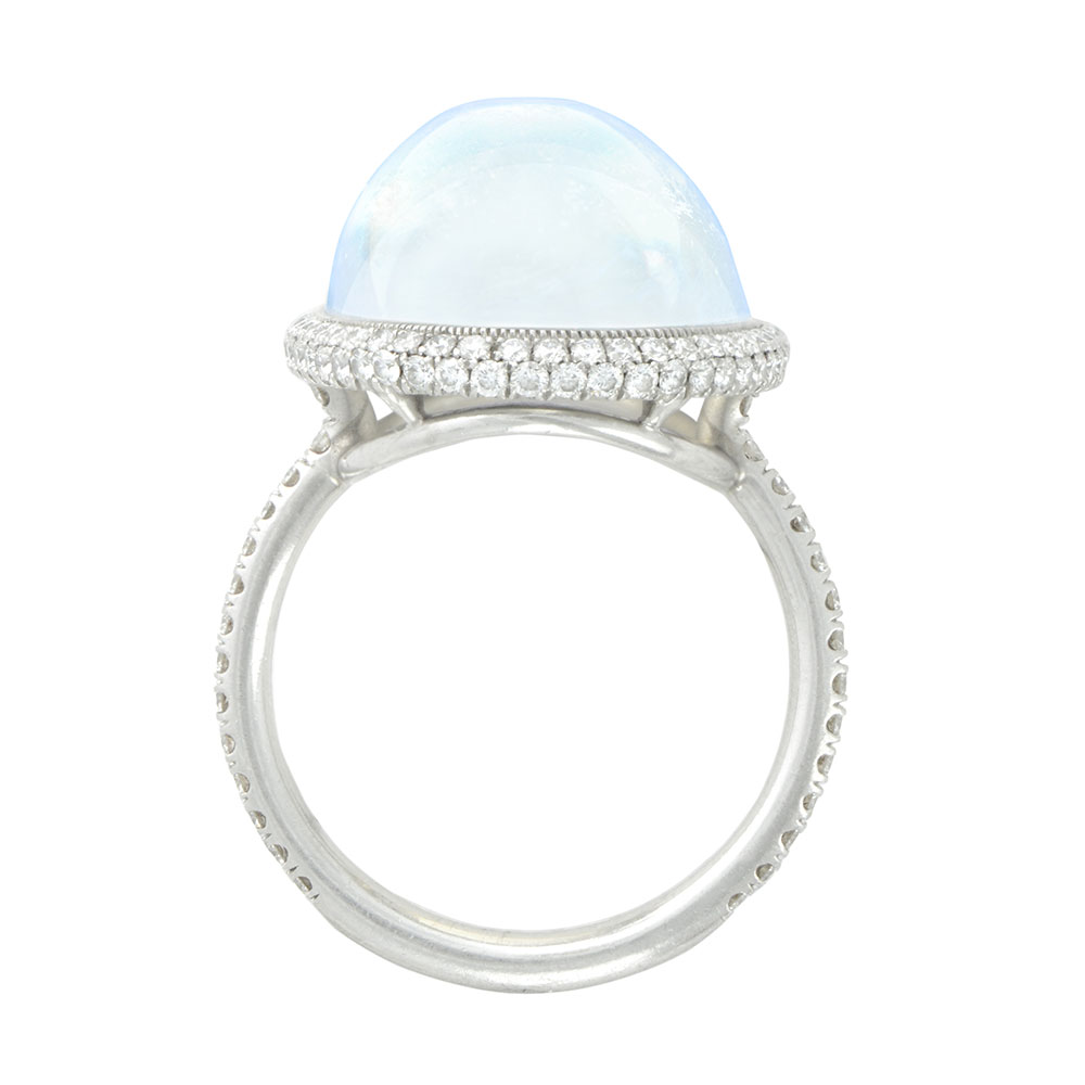CABACHON TRANSPARENT BLUE GEM MOONSTONE WITH ANTIQUE CUT DOWN PAVE AND MILGRAIN DETAIL, CRAFTED IN PLATINUM. 12.85 CTW