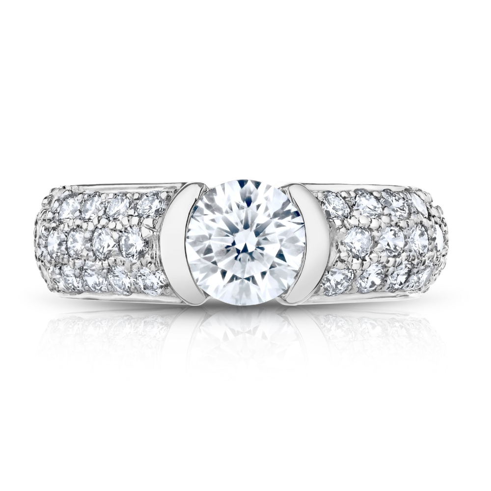 ROUND BRILLIANT CENTER DIAMOND SET IN A 3 ROW DIAMOND PAVE TENSION BAND, CRAFTED IN PLATINUM