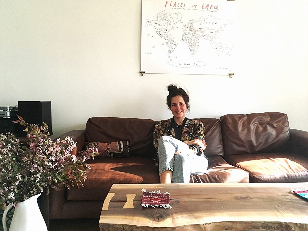 Kris at home in Chicago. Map of the world print personally dedicated to Kris and signed by artist  Oliver Jeffers  of  The Invisible Dog .