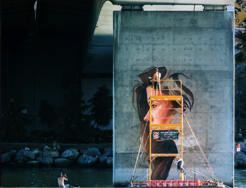 Sean on scaffolding under the Queensway Bridge in Long Beach, CA. Courtesy of Sean Yoro.
