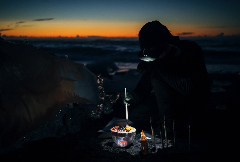 Sean prepares paint at dusk, Iceland. Courtesy of Sean Yoro.