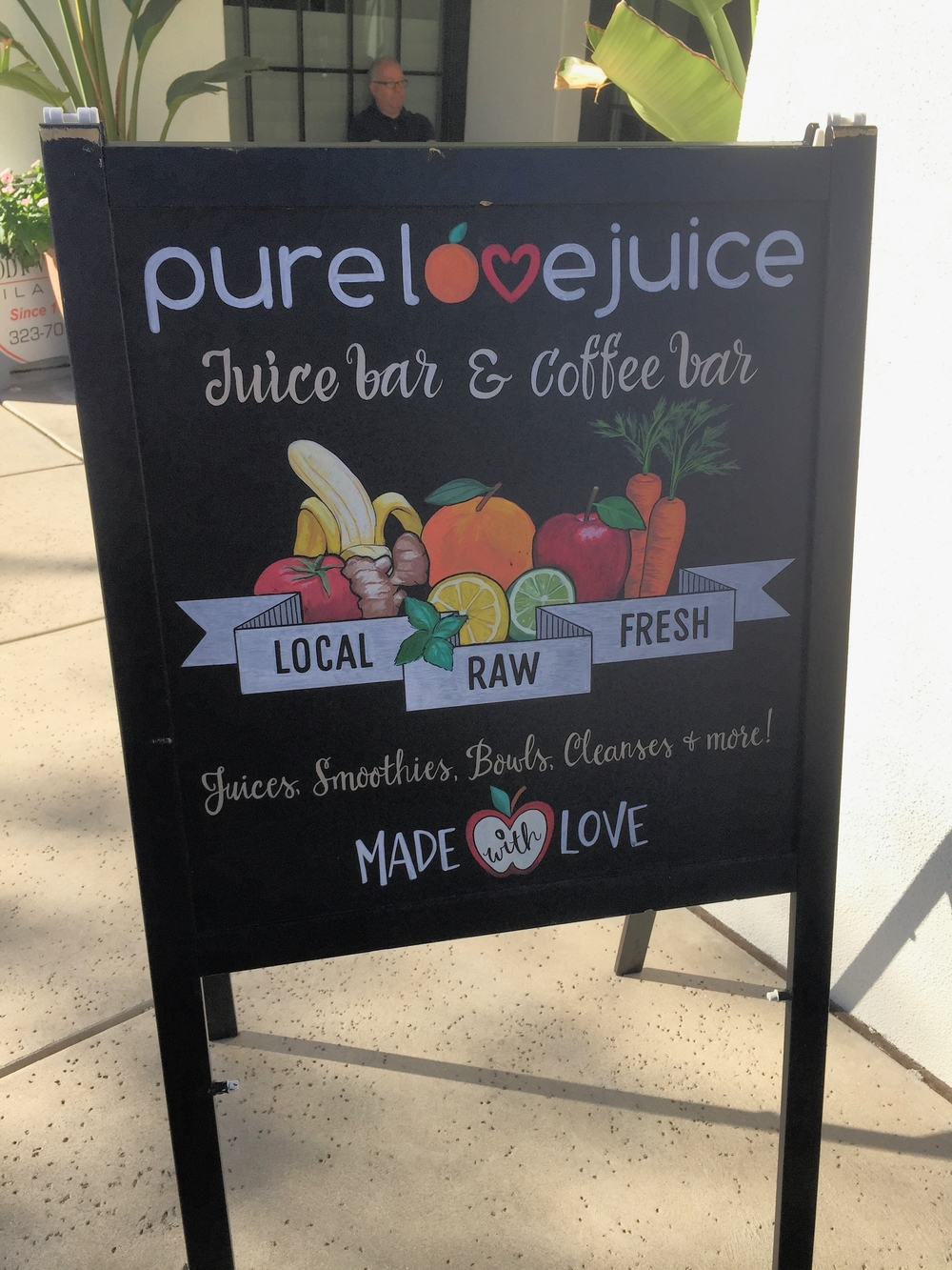 Juice Bar Pure Love Juice on 1980 East River Road, Tucson, Az is located below a pilates studio.
