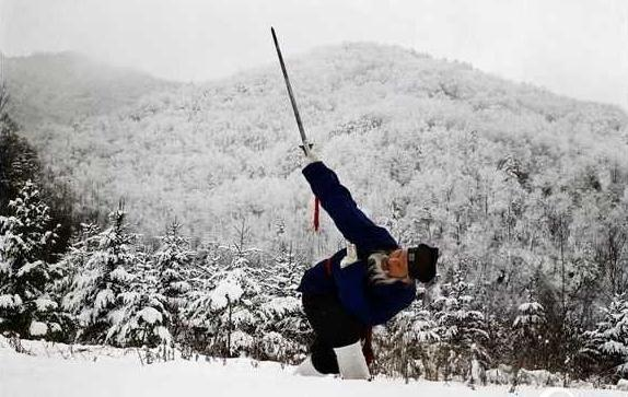 Daoist Master Guo Gao Yi practicing sword in the snow
