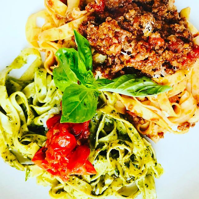 Homemade pasta with grandma served two ways, fresh pesto and tomatoes with olive oil and garlic, alongside pasta bolognese #italianfood #freshpasta