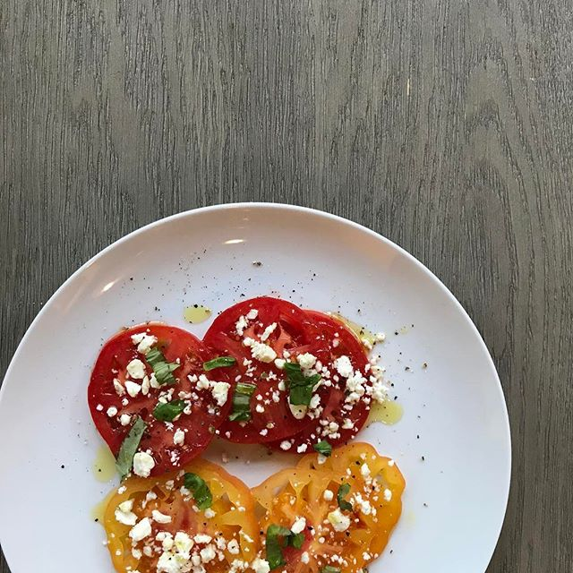 Heirloom tomatoes....get them while you can because the season is short!!Slice and sprinkle with feta cheese, olive oil, salt, pepper and a bit of fresh basil or mint! Perfect starter, side dish or lunch! #tablenspoon