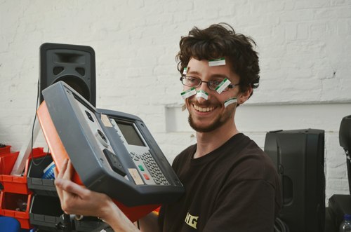 A moment of fun at the warehouse! Dubbed in the company as ''PAT tester extraordinaire'', Josh celebrates finishing testing of over 3000 electrical items and cables.