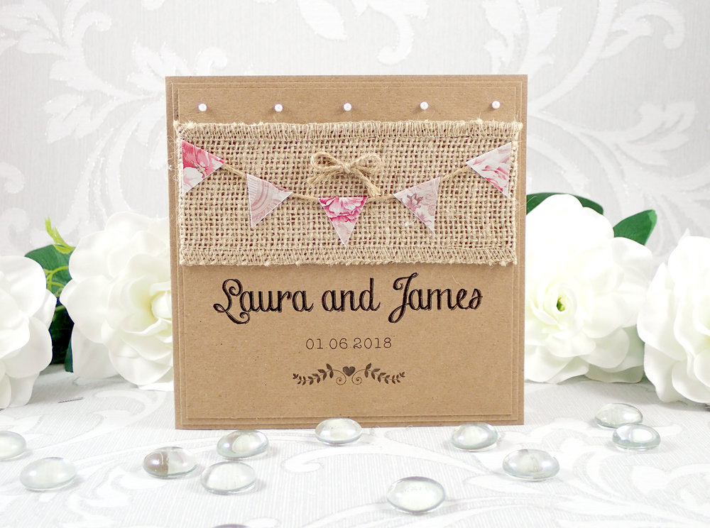 Aurora - One of our very most popular designs, Aurora is a wonderful choice for a rustic, vintage or barn wedding theme. Using floral hand-cut bunting, rustic hessian, twine and kraft cardstock, the design is one of our best-sellers.