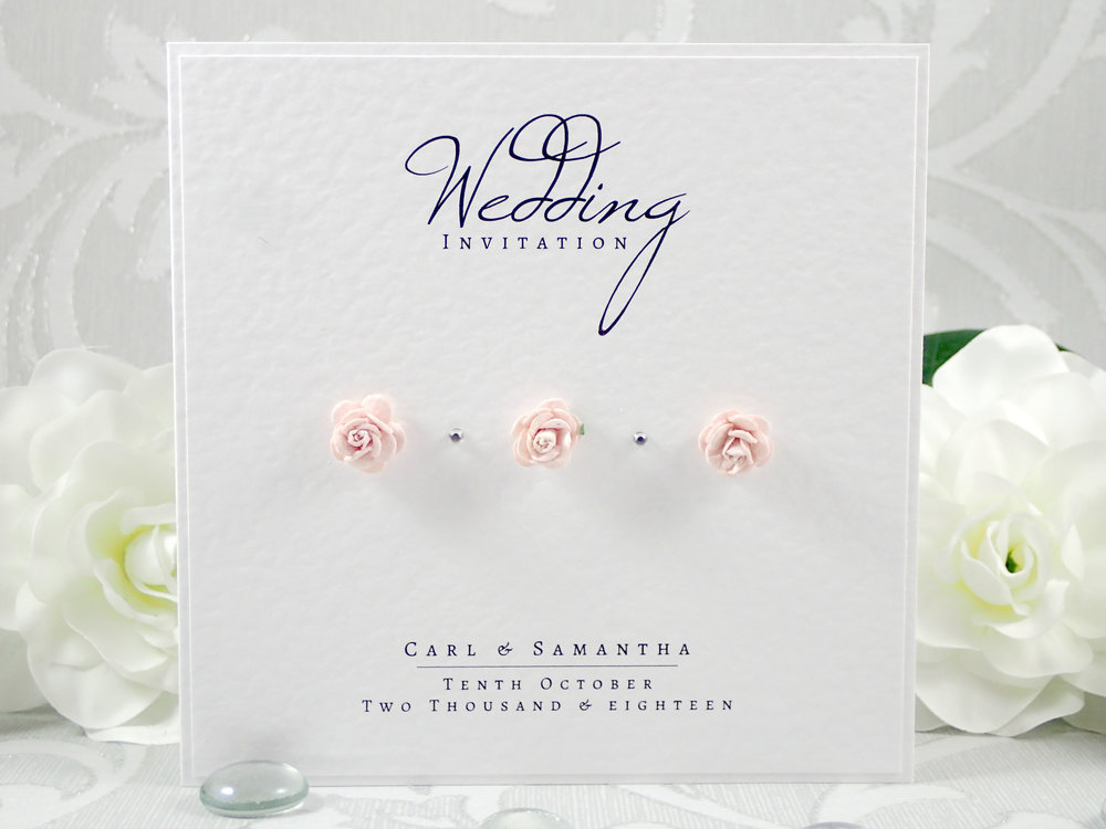 Eos - Cute and romantic, Eos uses gorgeous mulberry paper flowers alongside elegant typography for a subtle and modern design.