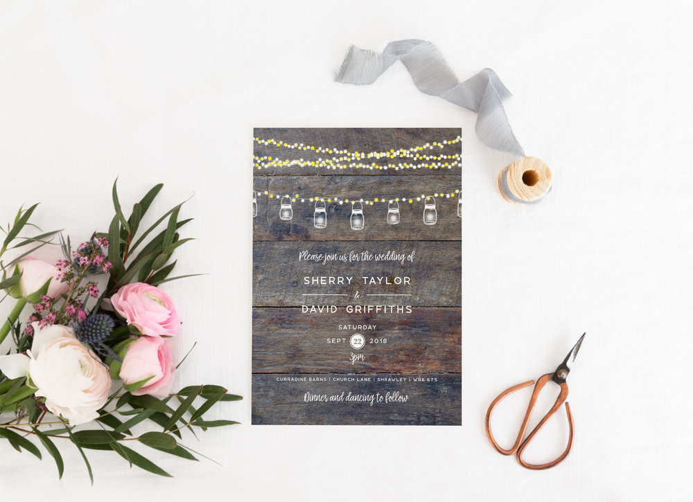 Kensington - Whether it's a barn wedding, or simply a wedding with a vintage, rustic theme, our Kensington collection blends beautifully. Combining a wood-effect background, string lights and mason jars, this design is fantastic for a retro barn theme.