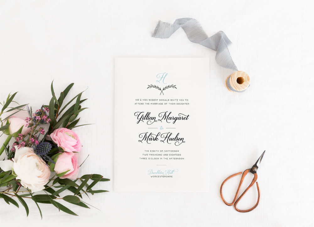 Paddington - Our Paddington collection uses a classical matrimonial style and a monogram of the wedded surname. With an emphasis on typography, the design is easily tailored to any colour combination to blend in with your wedding theme.