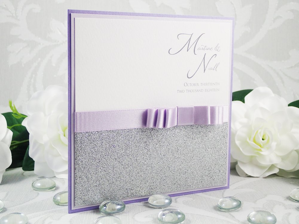 Leto - Luxury Bespoke Collection - priced from £1.50Our Leto design is classical and versatile. Choices come from the non-shed glitter paper, satin ribbon, two layers of cardstock and choice of embellishment - so you can easily achieve a match to your wedding's scheme.