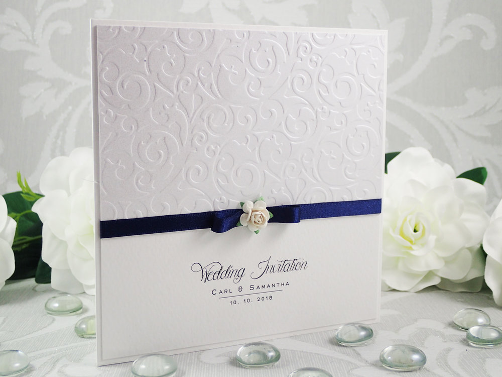 Atalanta - Classic Collection - priced from £1.75  Using a combination of gorgeous small paper roses, tactile embossed pearlescent cardstock and satin ribbon - Atalanta is a beautifully pretty and elegant wedding invitation and stationery option at a very attractive price point.