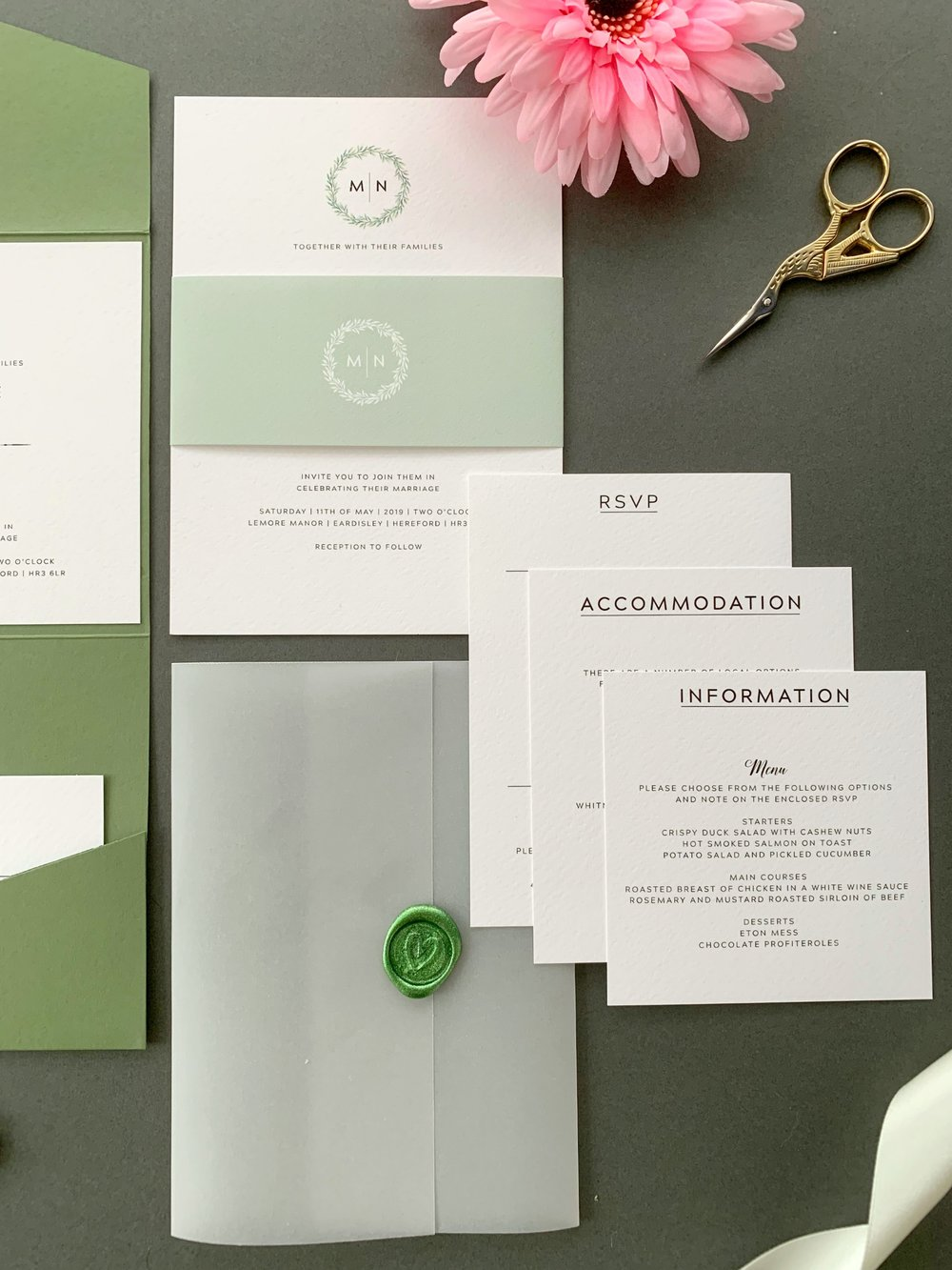 Mansion House Invitation Suite in Jet Black with Light Sage Paper Belly Band, with Sparkling Metallic Green Wax Seal on Vellum Jacket