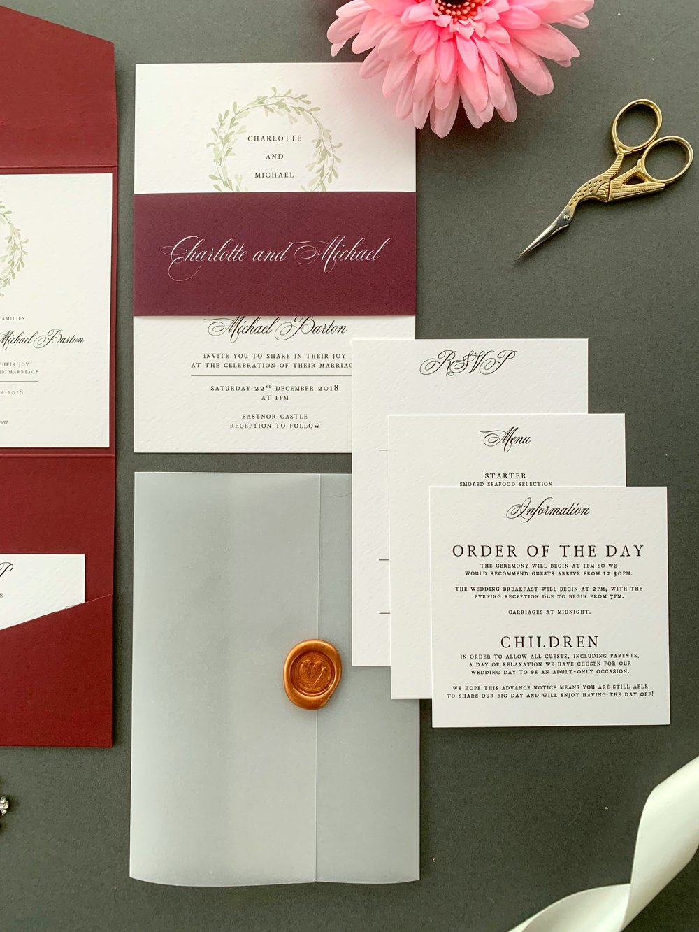 Oxford Invitation Suite in Jet Black with Paper Belly Band in Wine Berry, with Copper Wax Seal on Vellum Jacket