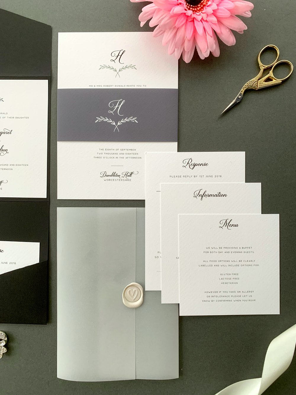 Paddington Invitation Suite in Jet Black and tiber with Fleet Grey Paper Belly and Pearl Ivory Wax Seal on Vellum Jacket