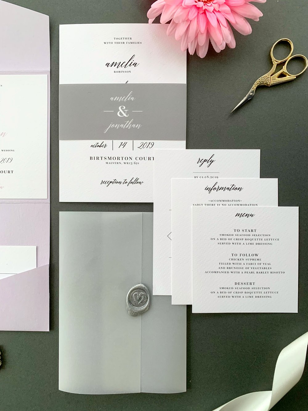 Westminster Invitation Suite in Jet Black and Nimble with Paper Belly band and metallic silver Wax Seal on Vellum Jacket