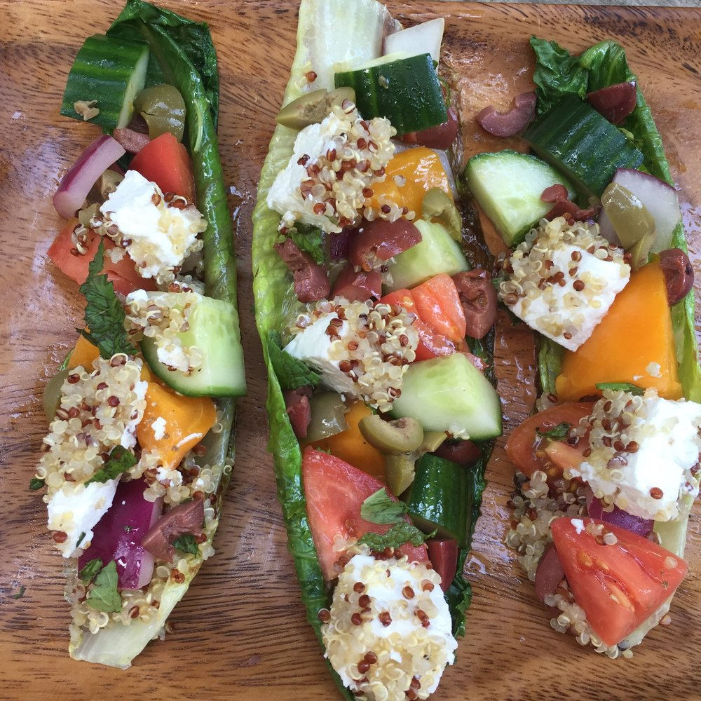 Quinoa crusted tofu and feta, with pickled tomato red onion, cucumber and olives in grilled lettuce boats.