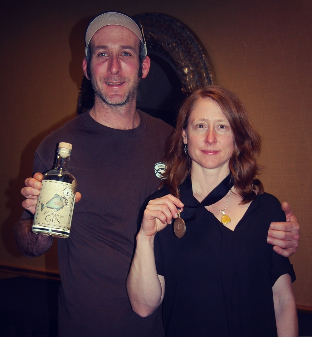 Heather and Sean with their gold medal for 50 Fathoms Gin.