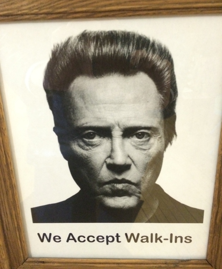 Sign in a barber shop, Grand Rapids, MN.