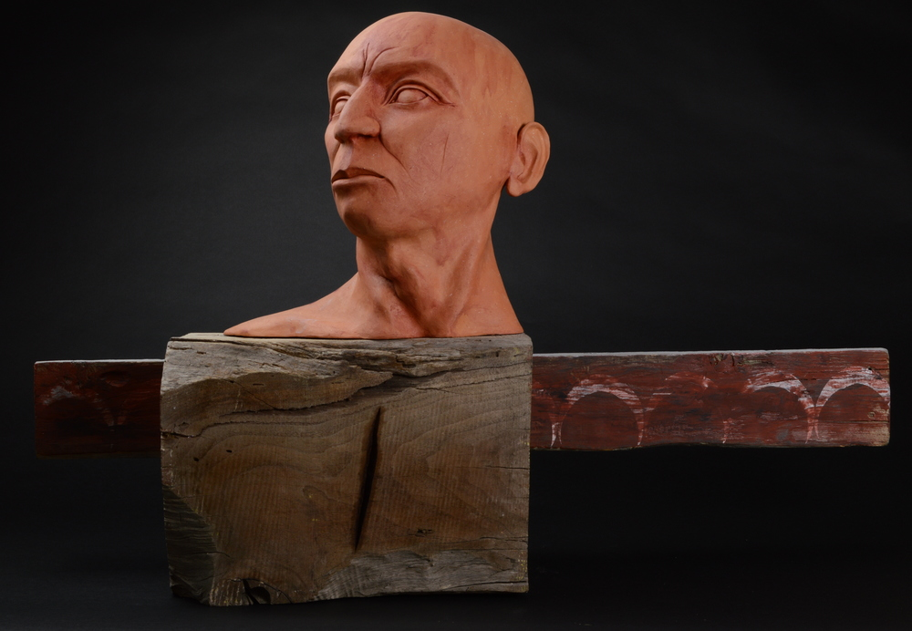 "Primitive.  H: 18"" Terra Cotta, Wood, Wax, Paint."