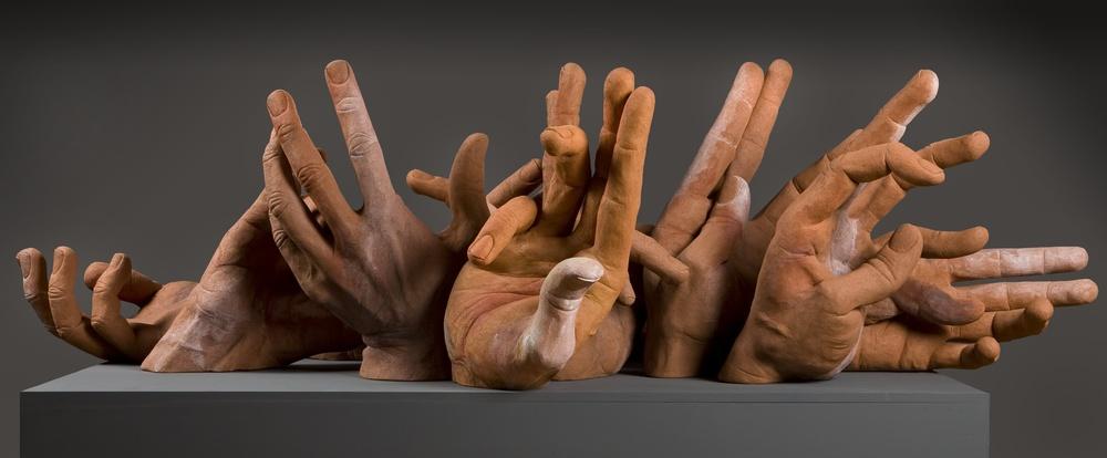 "Eleven Hands. L: 84"" Terra Cotta, Acrylic Paint."