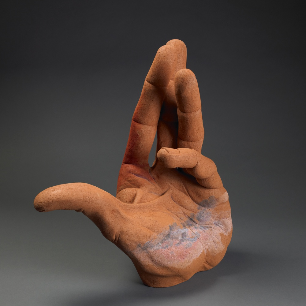 "Hand for High Plains.  H: 24"" Terra Cotta, Acrylic Paint."