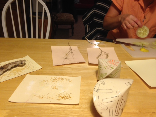 Yes, we are making photograms for dinner. N's ceramic pieces are on the right.