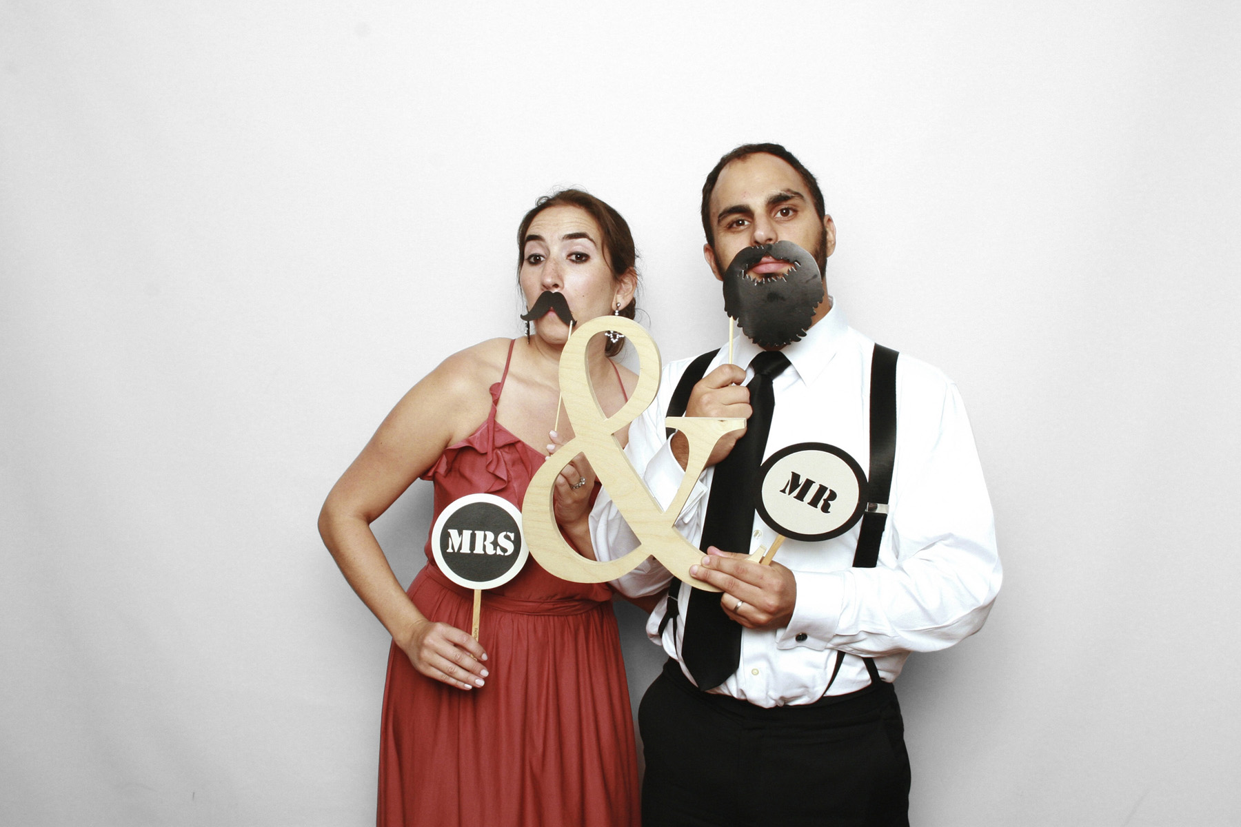 New York City Photo Booth at Chelsea Piers featured couple with stick props