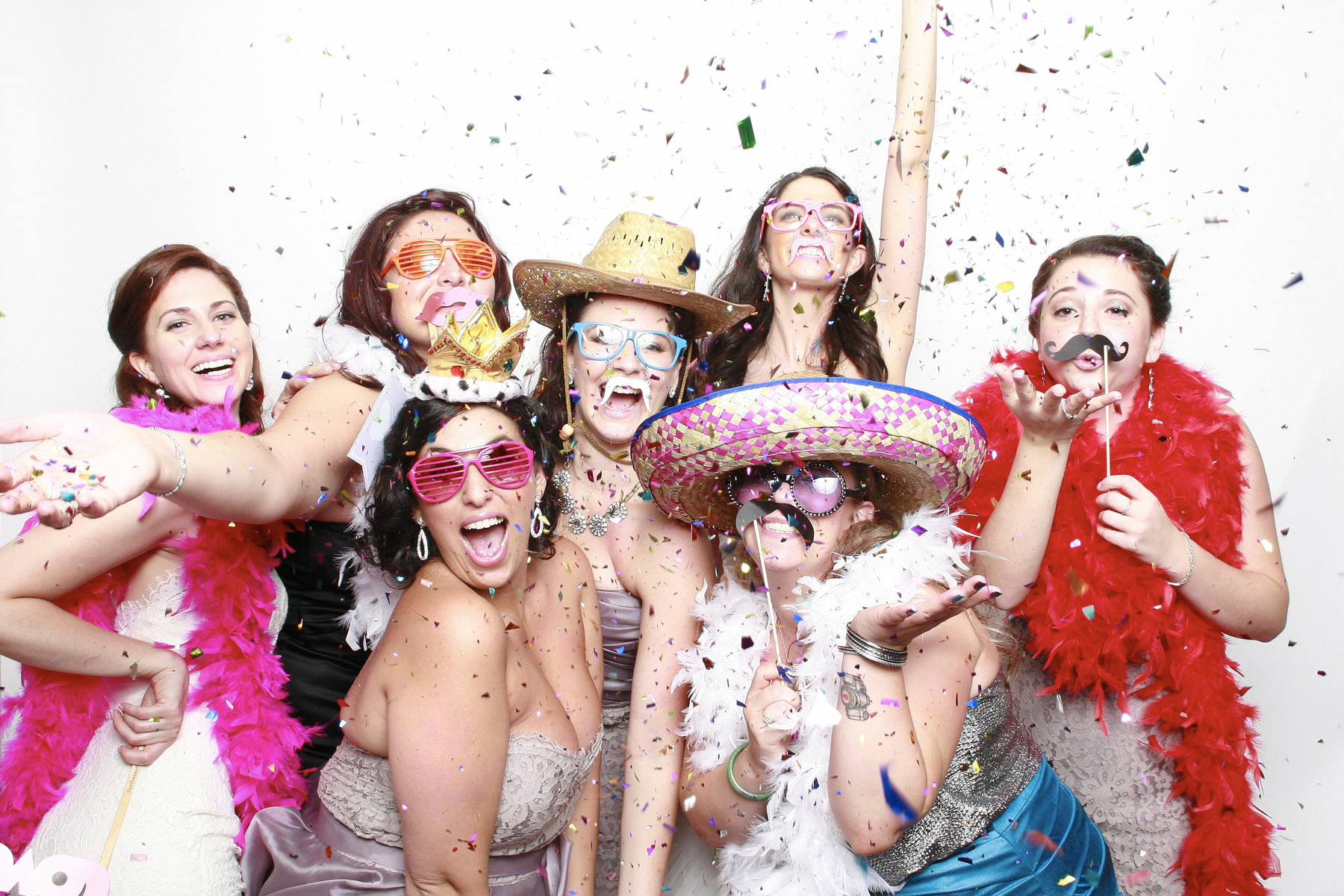 Bridesmaids in new york photo booth using confetti