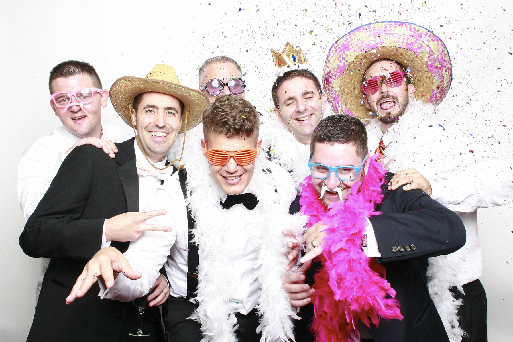 Groom in new york photo booth using confetti